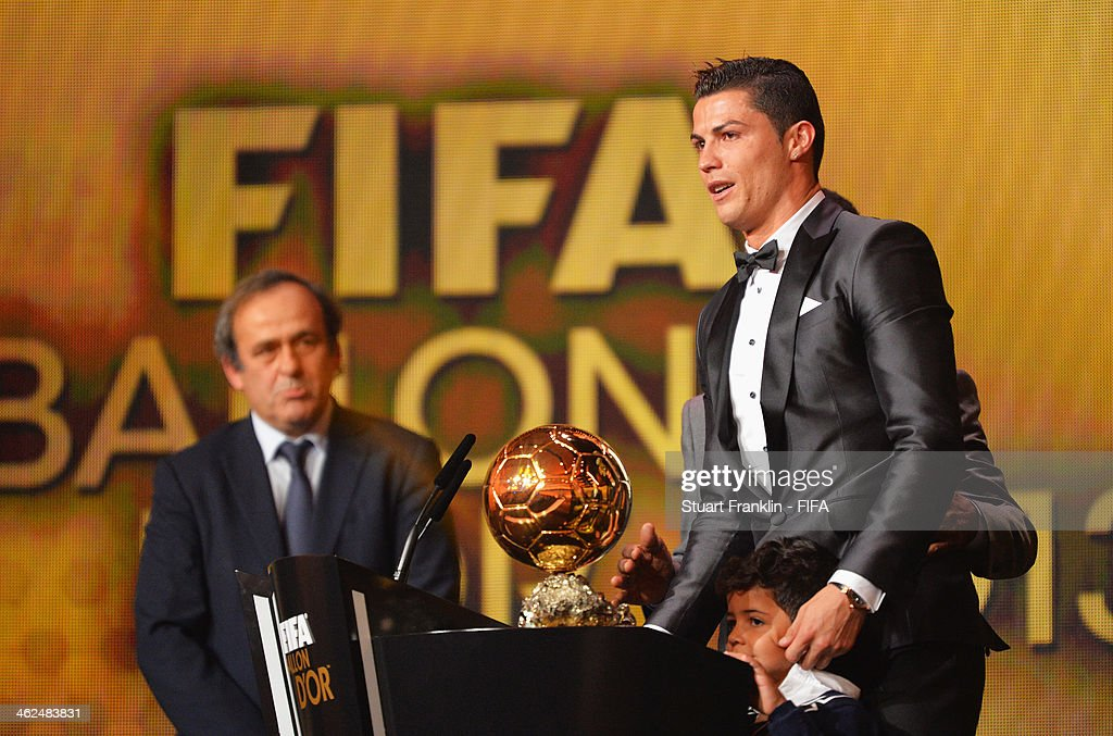 Ballon d'Or winner <a gi-track='captionPersonalityLinkClicked' href=/galleries/search?phrase=Cristiano+Ronaldo+-+Soccer+Player&family=editorial&specificpeople=162689 ng-click='$event.stopPropagation()'>Cristiano Ronaldo</a> of Portugal and Real Madrid gets emotional as he collects his award with his son <a gi-track='captionPersonalityLinkClicked' href=/galleries/search?phrase=Cristiano+Ronaldo+-+Soccer+Player&family=editorial&specificpeople=162689 ng-click='$event.stopPropagation()'>Cristiano Ronaldo</a> Junior with UEFA president <a gi-track='captionPersonalityLinkClicked' href=/galleries/search?phrase=Michel+Platini&family=editorial&specificpeople=206862 ng-click='$event.stopPropagation()'>Michel Platini</a> looking on during the FIFA Ballon d'Or Gala 2013 at the Kongresshaus on January 13, 2014 in Zurich, Switzerland.