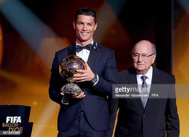 Ballon d'Or winner Cristiano Ronaldo of Portugal and Real Madrid accepts his award as FIFA President Joseph S Blatter looks on during the FIFA Ballon...