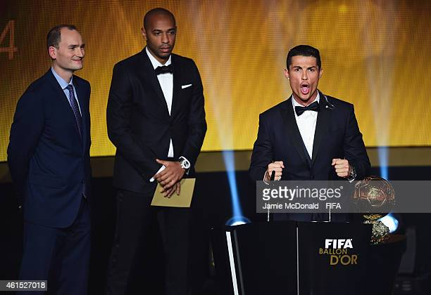 Ballon d'Or winner Cristiano Ronaldo of Portugal and Real Madrid accepts his award with Thierry Henry of France and Amaury Sport Organisation...