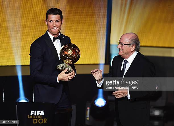 Ballon d'Or winner Cristiano Ronaldo of Portugal and Real Madrid accepts his award with FIFA President Joseph S Blatter during the FIFA Ballon d'Or...
