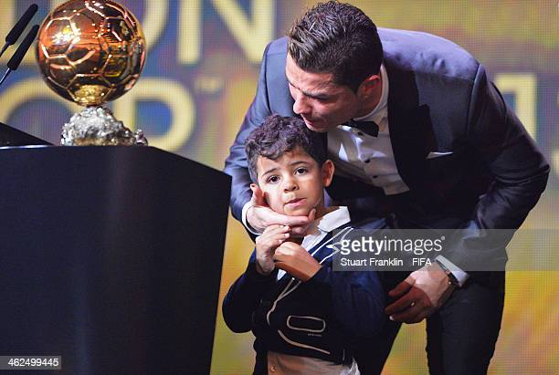 Ballon d'Or winner Cristiano Ronaldo of Portugal and Real Madrid kisses his son Cristiano Ronaldo Junior during the FIFA Ballon d'Or Gala 2013 at the...