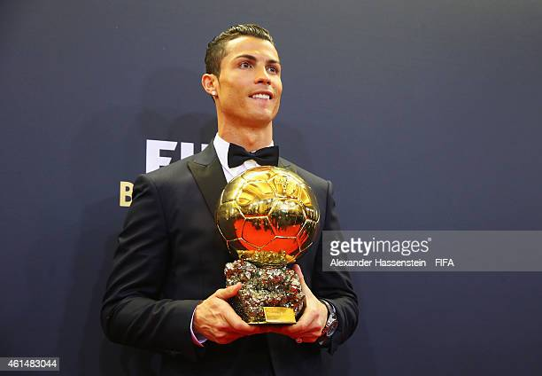 Ballon d'Or winner Cristiano Ronaldo of Portugal and Real Madrid poses with his award during the FIFA Ballon d'Or Gala 2014 at the Kongresshaus on...