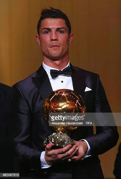 Ballon d'Or winner Cristiano Ronaldo of Portugal and Real Madrid poses with his award during the FIFA Ballon d'Or Gala 2013 at the Kongresshaus on...