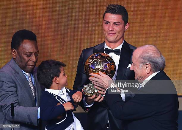 Ballon d'Or winner Cristiano Ronaldo of Portugal and Real Madrid with his son Cristiano Ronaldo Jr accepts his award from FIFA President Joseph S...