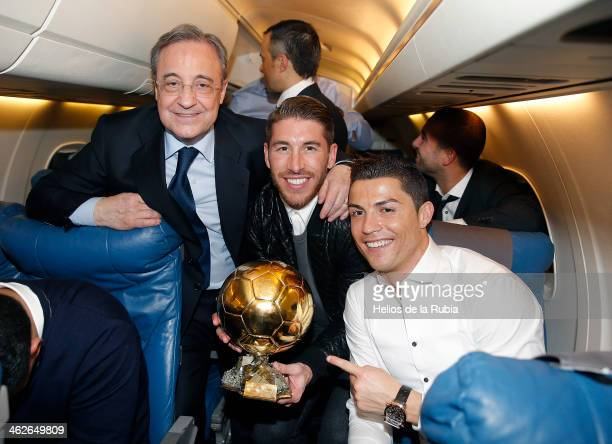 Ballon d'Or winner Cristiano Ronaldo poses with Real Madrid teammate Sergio Ramos and Real Madrid President Florentino Perez on the flight back after...