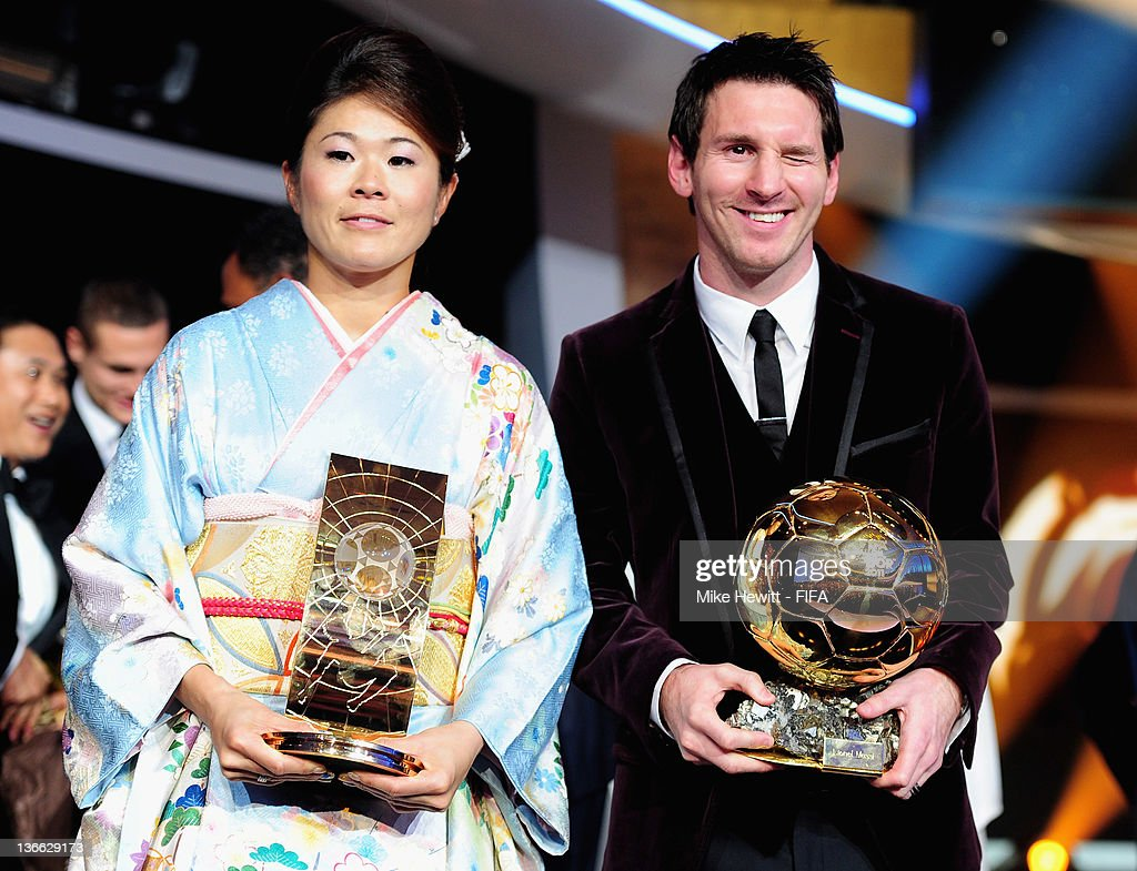 Ballon d'Or winner Lionel Messi and FIFA Women's World Player of the Year winner Homare Sawa of Japan pose with their trophies after the FIFA Ballon d'Or Gala 2011 at the Kongresshaus on January 09, 2012 in Zurich, Switzerland.