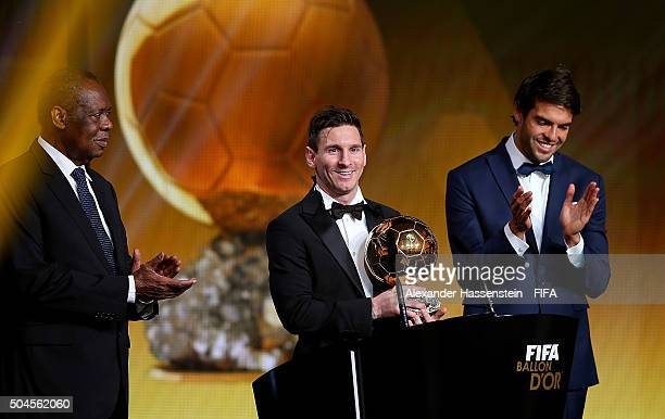 Ballon d'Or winner Lionel Messi of Argentina and Barcelona accepts his award with FIFA Acting President Issa Hayatou and Kaka of Brazil during the...