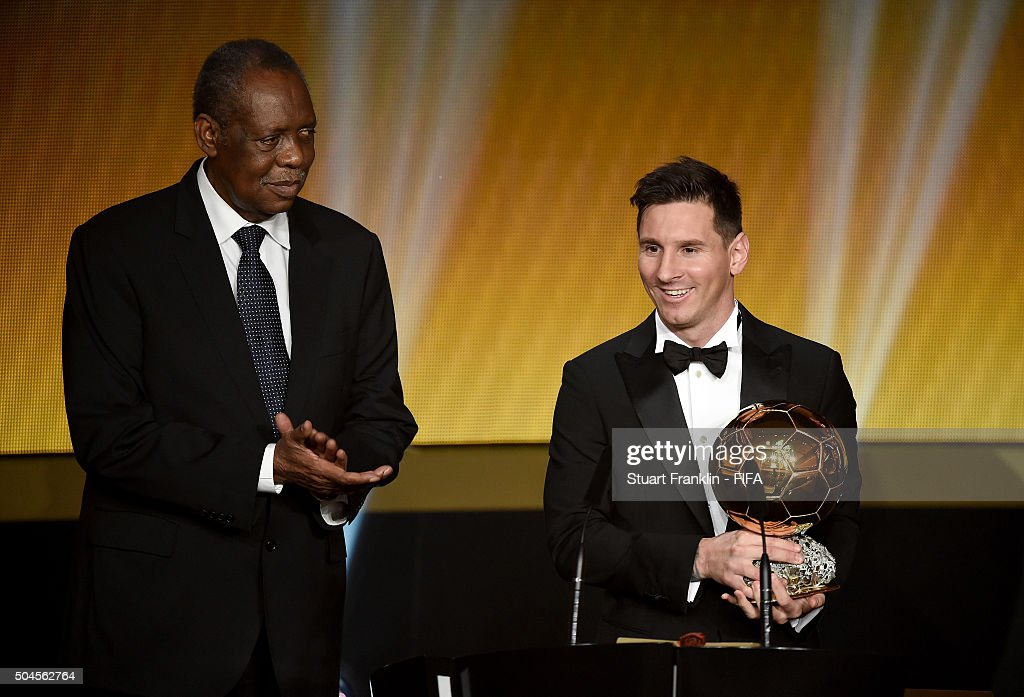 Ballon d'Or winner <a gi-track='captionPersonalityLinkClicked' href=/galleries/search?phrase=Lionel+Messi&family=editorial&specificpeople=453305 ng-click='$event.stopPropagation()'>Lionel Messi</a> of Argentina and Barcelona accepts his award with FIFA Acting President <a gi-track='captionPersonalityLinkClicked' href=/galleries/search?phrase=Issa+Hayatou&family=editorial&specificpeople=541876 ng-click='$event.stopPropagation()'>Issa Hayatou</a> during the FIFA Ballon d'Or Gala 2015 at the Kongresshaus on January 11, 2016 in Zurich, Switzerland.