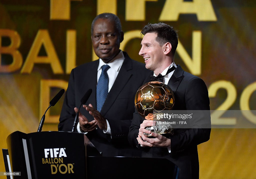 Ballon d'Or winner Lionel Messi of Argentina and Barcelona accepts his award with FIFA Acting President Issa Hayatou during the FIFA Ballon d'Or Gala...