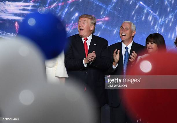 Ballons fall as Republican presidential candidate Donald Trump and Indiana Governor Mike Pence clap on the last day of the Republican National...