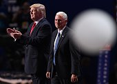 Ballons fall as Republican presidential candidate Donald Trump and Indiana Governor Mike Pence look on the last day of the Republican National...