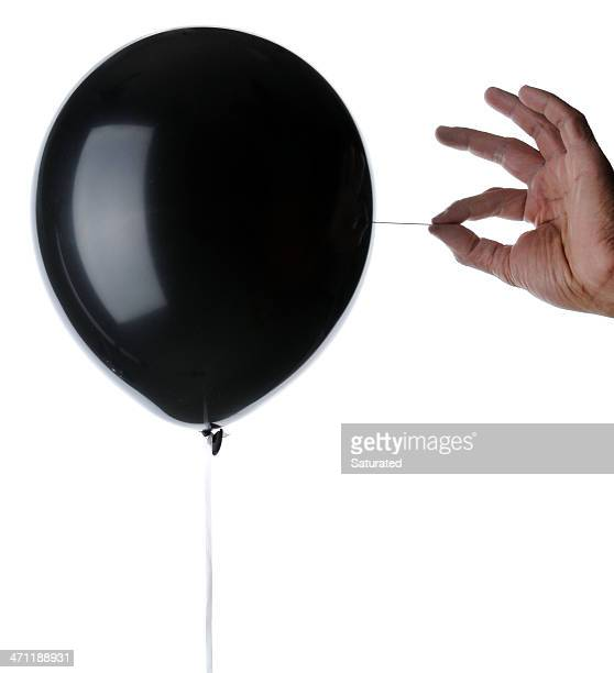 Balloon About to Be Popped with A Needle