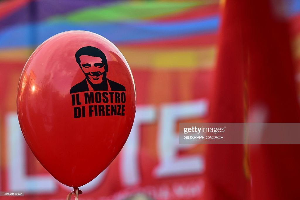 A balloon bearing a portrait of Italian Prime Minister Matteo Renzi reading 'the monster of Florence' is diplayed in Milan during an eighthour strike...