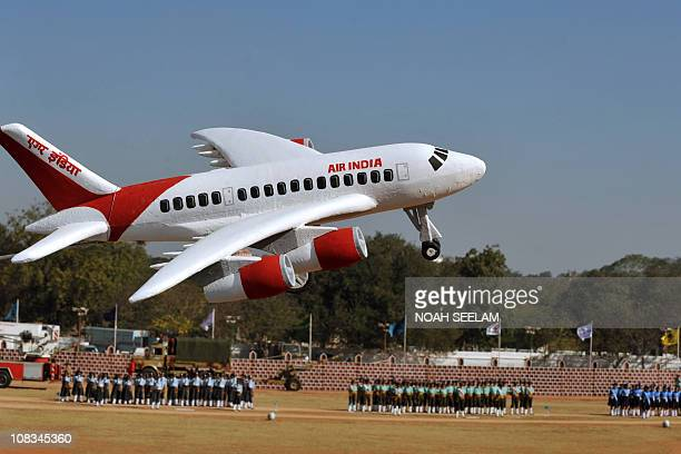 A balloon in the shape of an Air India aircraft is seen during a Republic Day parade at Secunderabad the twin city of Hyderabad on January 26 2011...