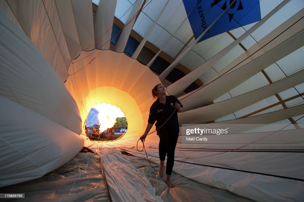 A balloon is inflated at the Bristol International Balloon Fiesta at the Ashton Court estate on August 9 2013 in Bristol England Due to the wind...