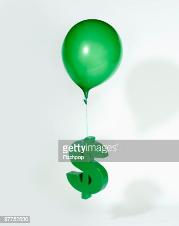 Balloon lifting Dollar sign  : Stock Photo