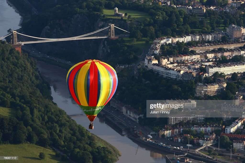 A balloon moves in front of the Clifton Suspension Bridge during day two of the Bristol Balloon Fiesta on August 10 2007 in Bristol England