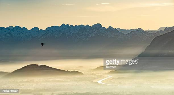 balloon over foggy borderland between austria and switzerland