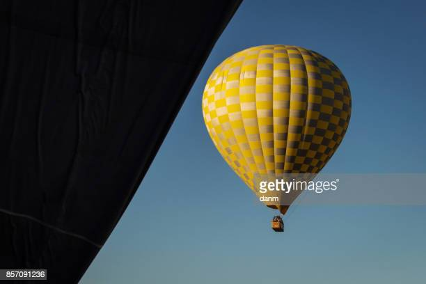 Balloon over Valleys of Cappadocia in background, aerial view