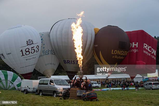 A balloon pilot fires the burners in a hot air balloon basket on the second day of the Bristol International Balloon Fiesta on August 12 2016 in...