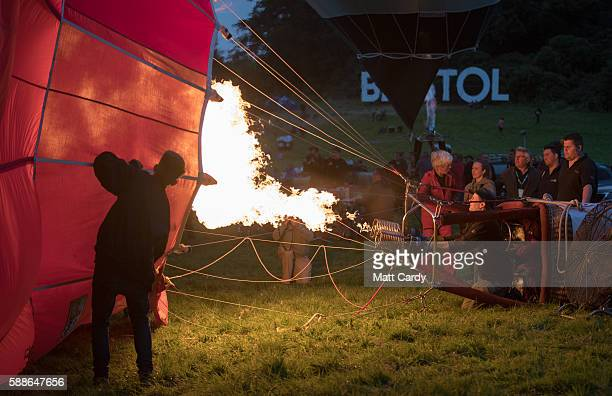 A balloon pilot fires the burners in a tethered hot air balloon on the second day of the Bristol International Balloon Fiesta on August 12 2016 in...