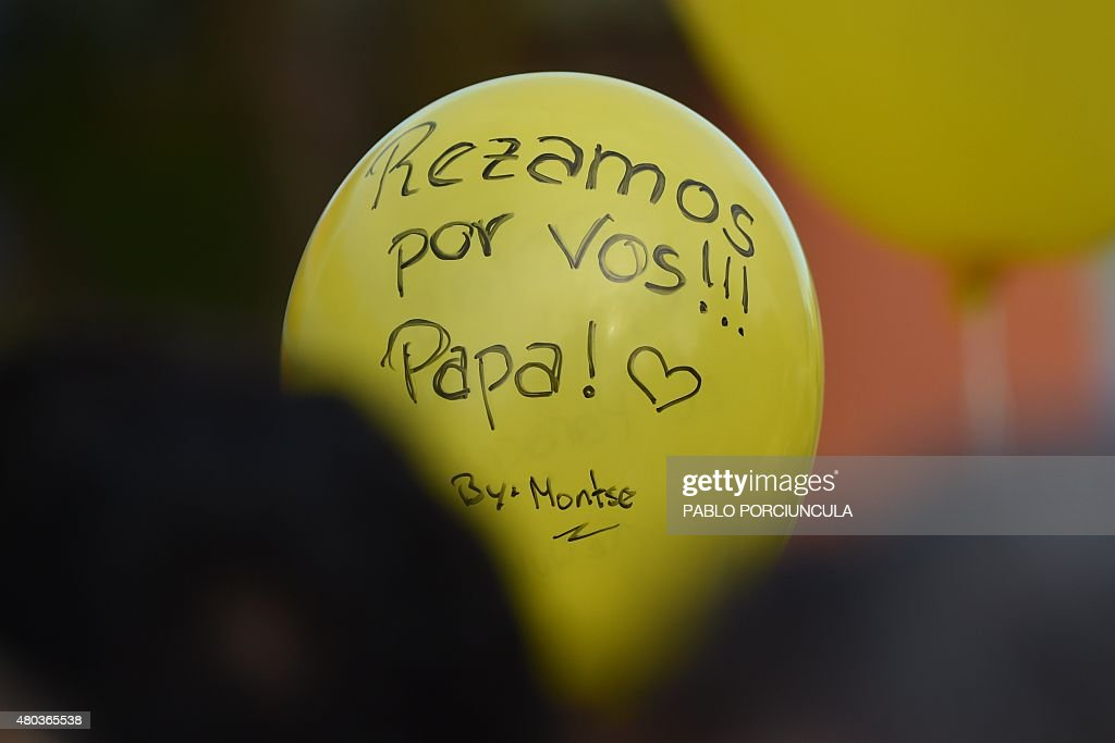 A balloon reading 'We Pray for You Pope' is seen amid the crowd of people waiting to get a glimpse of Pope Francis during his visit to the Peadiatric...