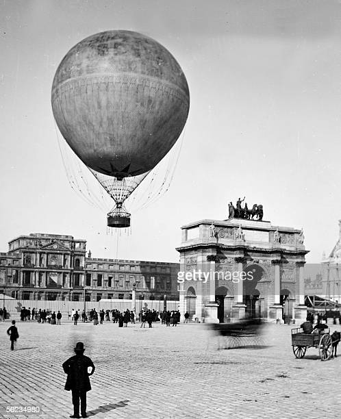 Balloon taking off On background the ruins of Tuileries View taken of the square of Carrousel in 1878