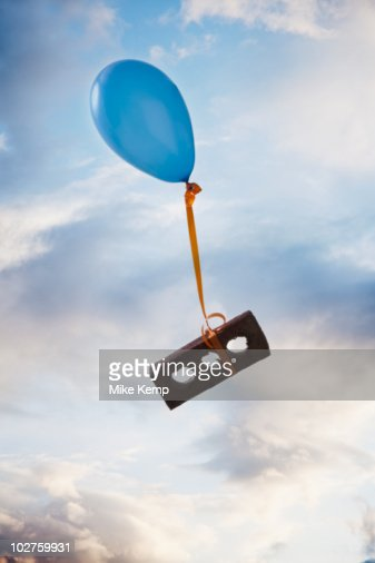 Balloon tied to a brick