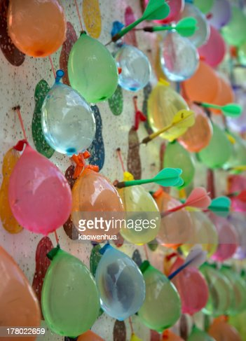 Balloon with colored arrows : Stock Photo