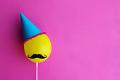 Birthday party balloon with party hat and moustache