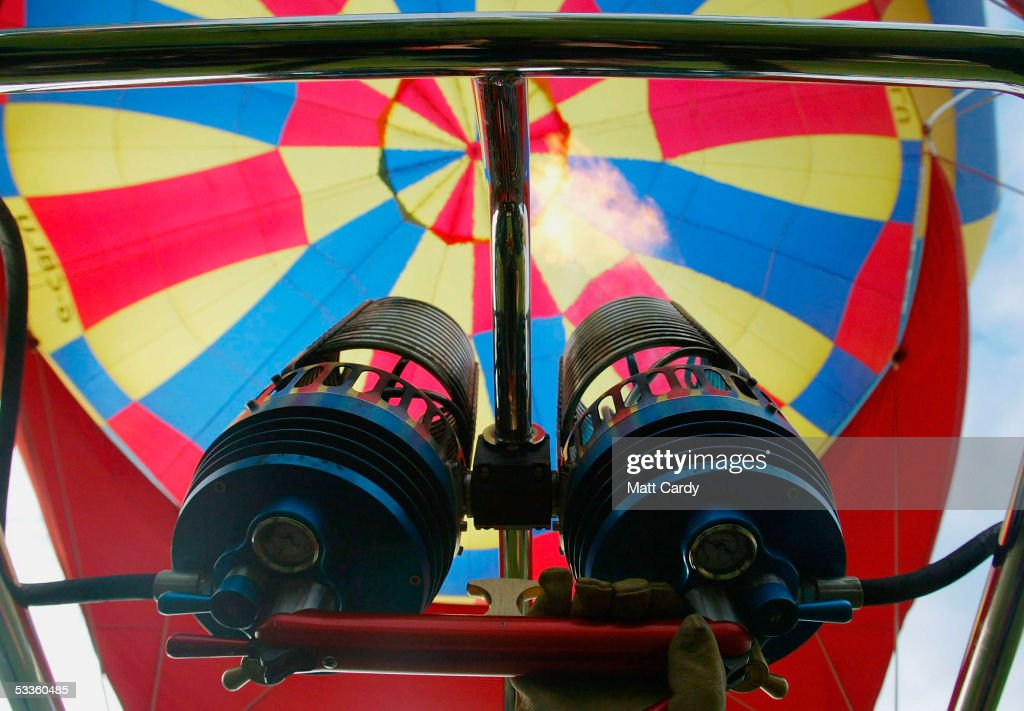 A balloonist fires his balloon's burners as hot air balloons fill the sky at the early morning mass balloon ascent kicking off the second day of the...