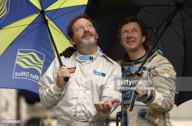 Balloonists Andy Elson and Colin Prescot look despairingly at the skies at the Royal Institute in London The two British pilots who plan to break the...