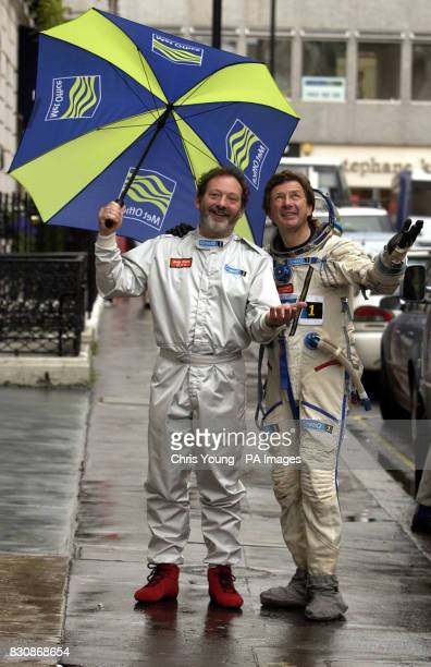 Balloonists Andy Elson and Colin Prescot look despairingly at the skies at the Royal Institute in London * The two British pilots who plan to break...