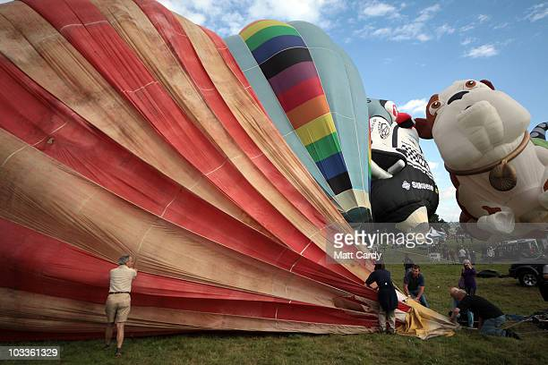 Balloonists help deflate the Bristol Belle the first modern balloon in Western Europe that was built in 1967 at the Bristol International Balloon...