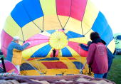 Balloonists prepare to launch on the second day of the 38th Annual Albuquerque International Balloon Fiesta on October 4 2009 in Albuquerque New...