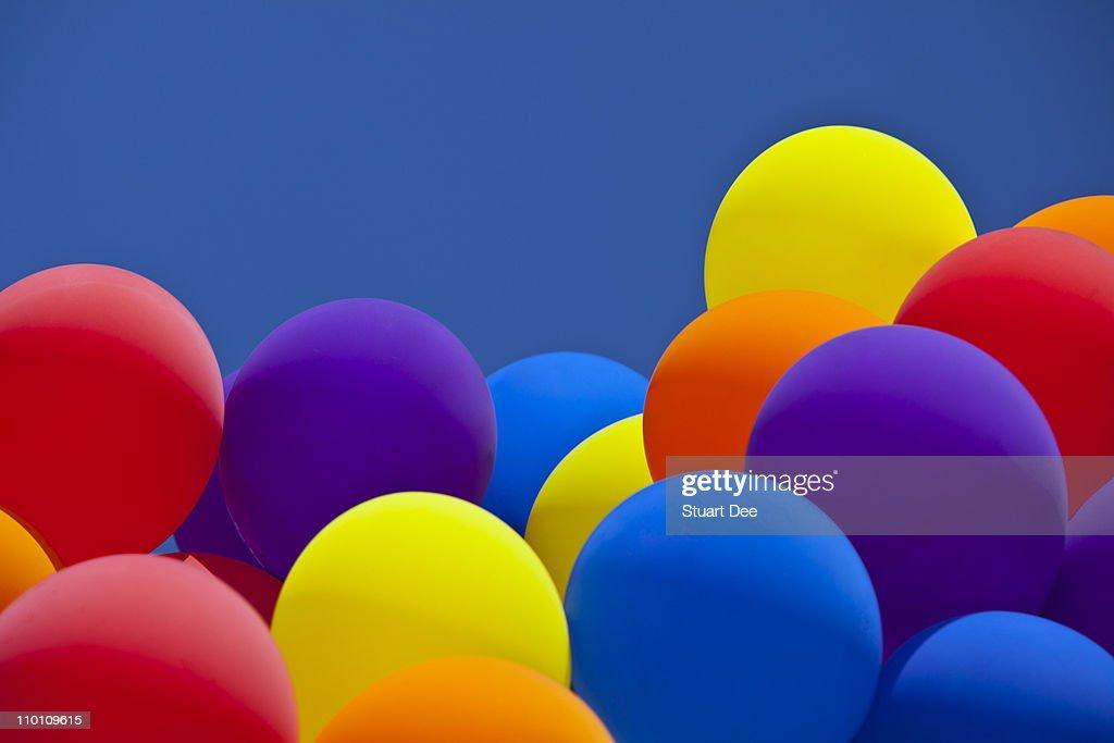 Balloons against a deep blue sky : Stock Photo