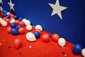 Balloons and confetti are strewn on the floor of the Republican National Convention after the closing of the penultimate night of the event at...