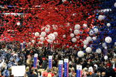 Balloons and confetti drop from the ceiling at the end of Republican US presidential nominee US Sen John McCain's speech on day four of the...