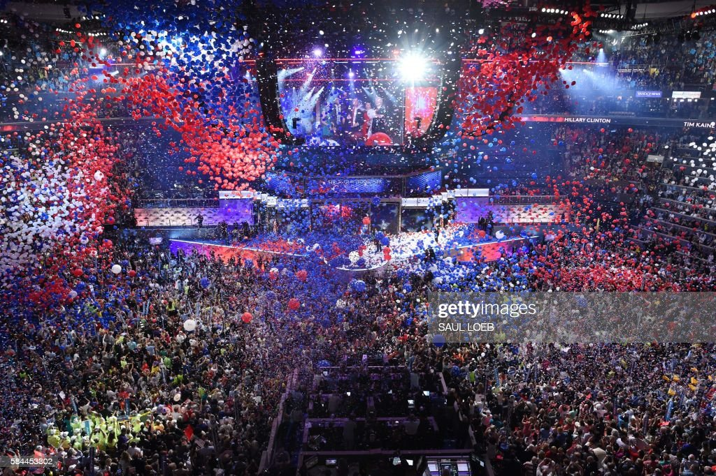 TOPSHOT - Balloons and confetti fall following a speech by Democratic presidential nominee Hillary Clinton after accepting the nomination during the fourth and final night of the Democratic National Convention at the Wells Fargo Center, July 28, 2016 in Philadelphia, Pennsylvania. /