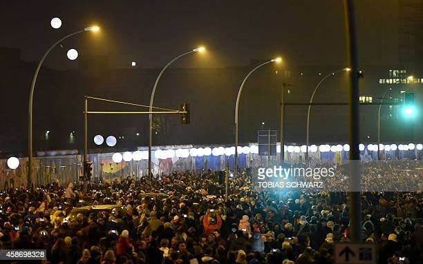 Balloons are released along the preserved segment of the Berlin Wall called East Side Gallery where the Light Border a lightened balloons...