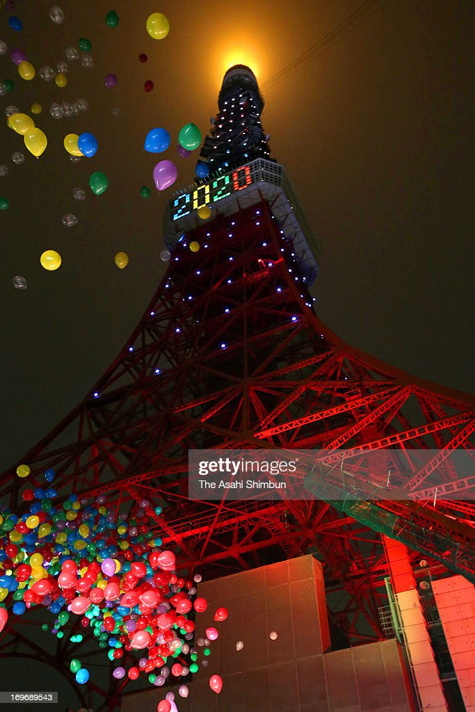 Balloons are released in front of the illuminated Tokyo Tower on May 30, 2013 in Tokyo, Japan.