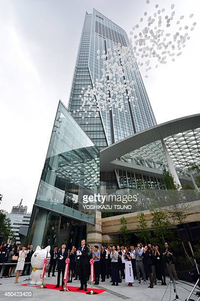 Balloons are released into the air at the ribboncutting ceremony to open Tokyo's new landmark Toranomon Hills complex on June 11 2014 The 52storey...