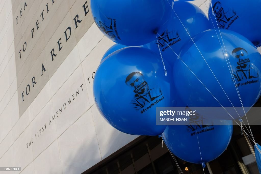 Balloons bearing the image of Bahrani human rights activist Nabeel Rajab are seen at an Amnesty International 'write-a-thon' on November 20, 2012 outside of the Newseum in Washington, DC. Rajab was sentenced in August to three years in jail for taking part in illegal gatherings. The write-a-thon is an annual Amnesty event to encourage human rights supporters to to write letters on behalf of prisoners of conscience. AFP PHOTO/Mandel NGAN