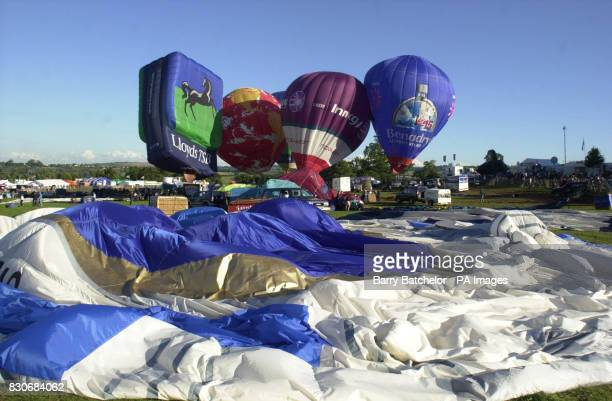 Balloons before lifting off for the first time in this year's Bristol International Balloon Fiesta but with special restrictions to stop them...