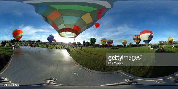 Balloons begin to take to the air over the Hamilton Lake during the Mass Ascension on the opening day of Balloons Over Waikato on March 22 2017 in...