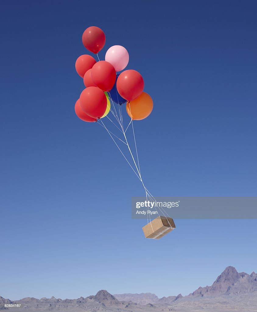 Balloons Carrying Box Across Sky : Stock Photo