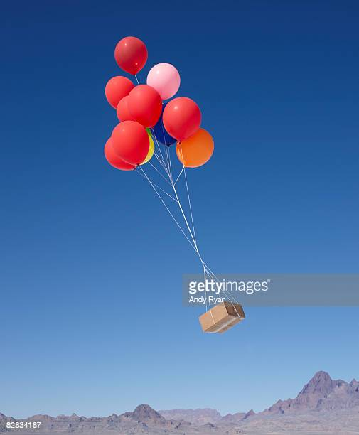 Balloons Carrying Box Across Sky