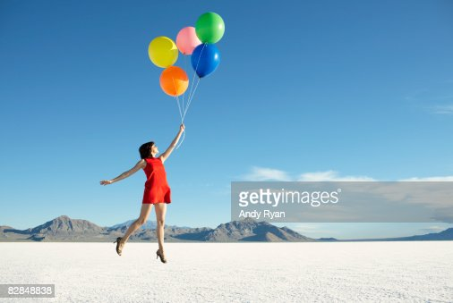 Balloons carrying off young woman