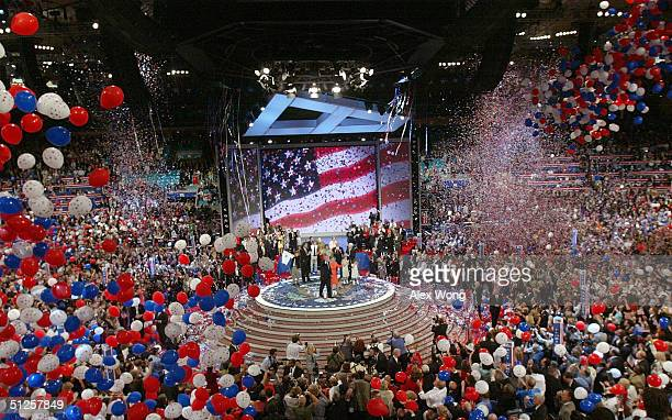 Balloons fall from the ceiling following US President George W Bush's speech accepting his party's nomination on the final night of the Republican...