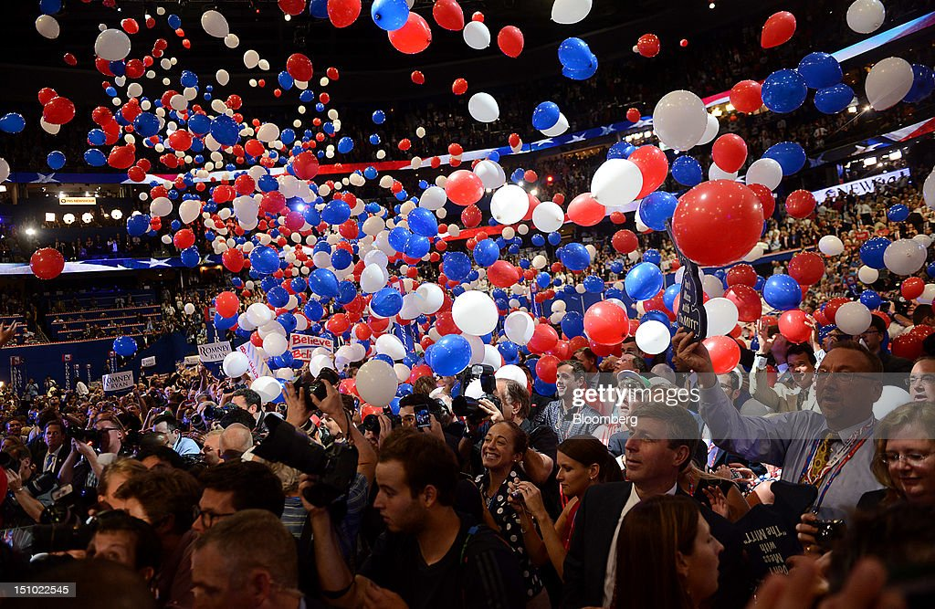 Balloons fall on delegates after Mitt Romney, Republican presidential candidate, unseen, spoke at the Republican National Convention (RNC) in Tampa, Florida, U.S., on Thursday, Aug. 30, 2012. Romney, a wealthy former business executive who served as Massachusetts governor and as a bishop in the Mormon church, is under pressure to show undecided voters more personality and emotion in his convention speech tonight, even as fiscal conservatives in his own party say he must more clearly define his plans for reining in the deficit and improving the economy. Photographer: Daniel Acker/Bloomberg via Getty Images